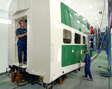 A photo depicting Ontario Northland staff refurbishing a passenger rail car