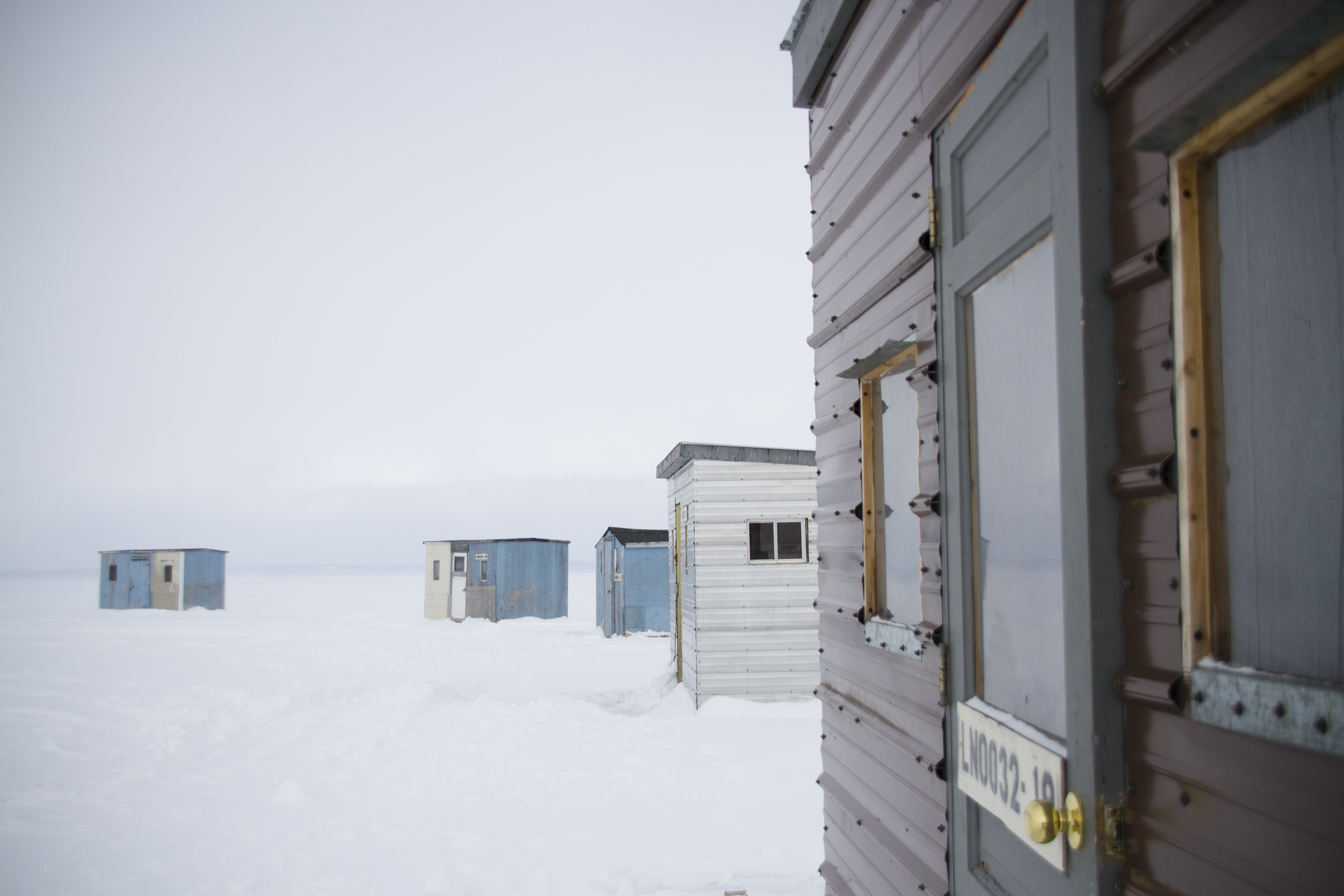 A photo of ice shacks on Lake Nipissing