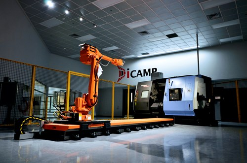 A photo of a robotic arm inside ICAMP