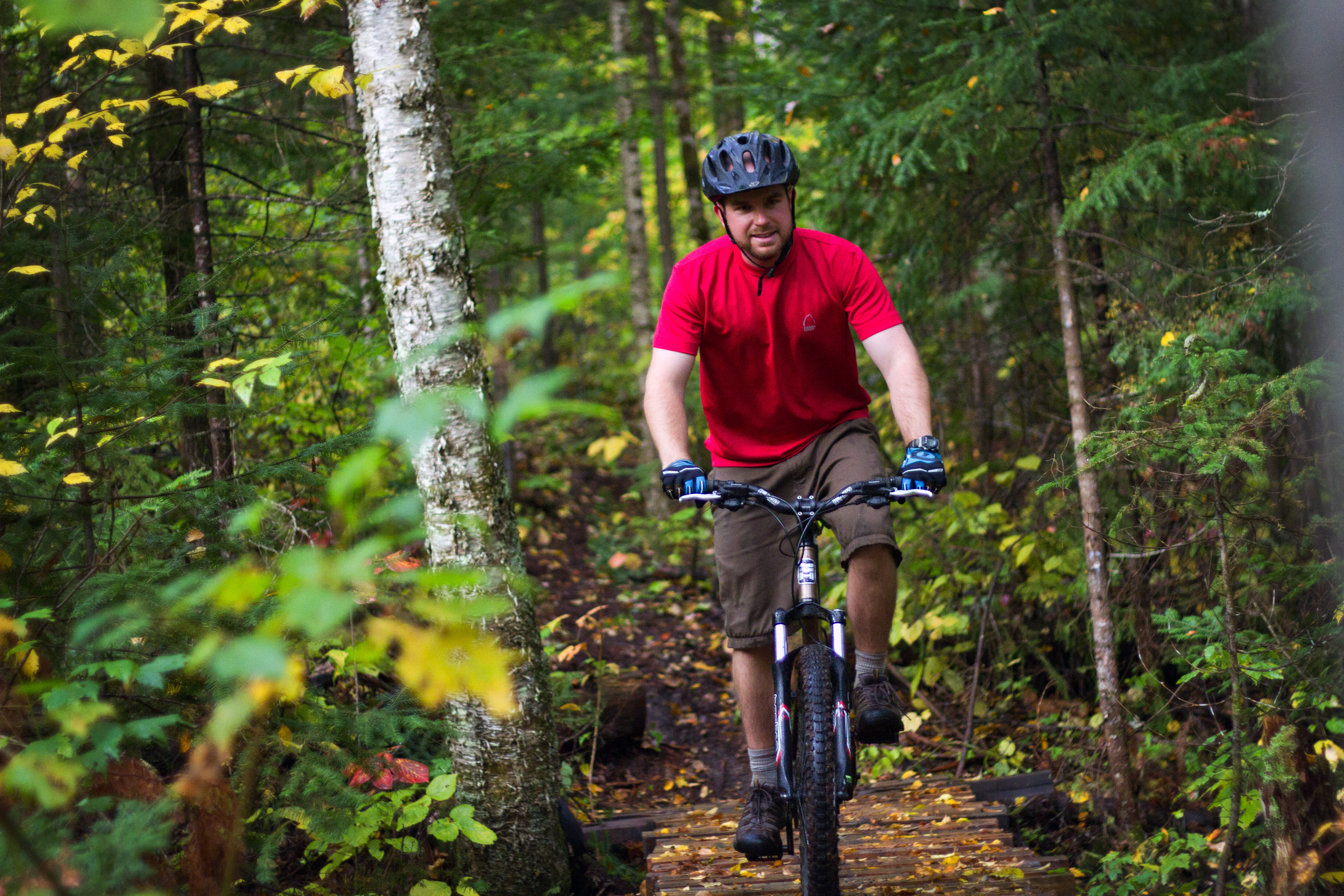 A photo of a man mountain biking in North Bay